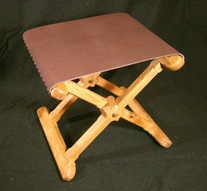 Folding stool with leather seat £150