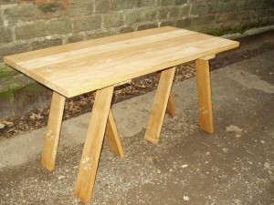 "Trestle tables from £250 oak or ash tops with oak bases Example -  Ash top ex1/4"" thick oak trestles 4'6"" x 2'6"" £295"